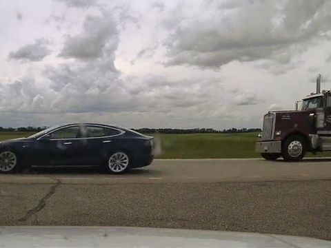 Tesla owner in Canada charged with 'sleeping' while driving over 90 mph