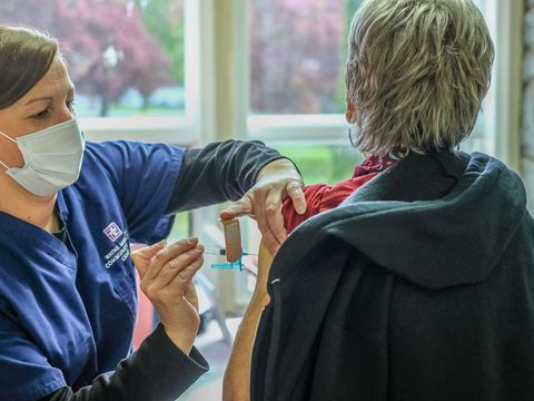 Vaccinated people can ditch masks and social distancing in most places, CDC says